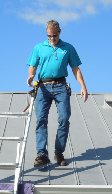 Brian inspecting a roof
